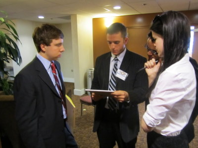 Security Council delegates discuss a document out in the hall