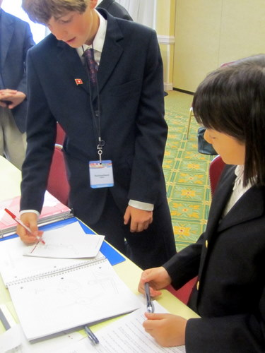 Middle school delegates draw pictures to communicate their resolution ideas