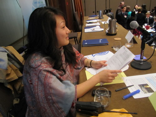 General Assembly Chair Jeniffer Kim gets ready to start committee