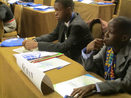 Delegates from Sudan listen to speeches
