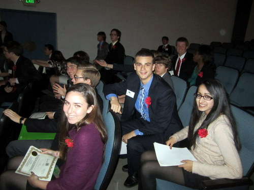 The LAIMUN staff wait to present awards at closing ceremonies