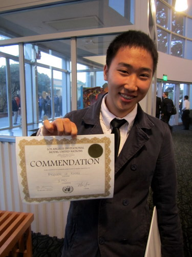 A Korean American Coalition delegate receives an award at his first MUN conference