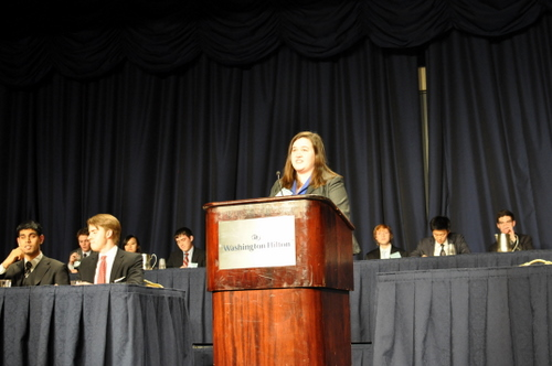 Executive Director Caitlin Pharo speaks at opening ceremonies