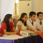 The Committee Directors or Dais Staffers  listening attentively to delegates during ROTMUN formal committee sessions.