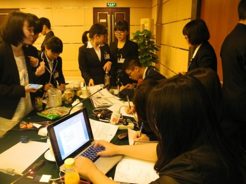 Delegates discussing their working paper with YMUN-China chairs