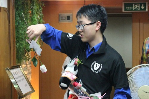 Roses and Pandas delivered by Director-General, Dennis Wang