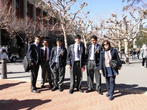 Standing left to right: Junaid Khalid Khan, Abdullah Suhail Mannan, Talha Yousaf, Afraz Arif Khan, Mirza Yahya Baig, Mrs. Maleeha Khwaja