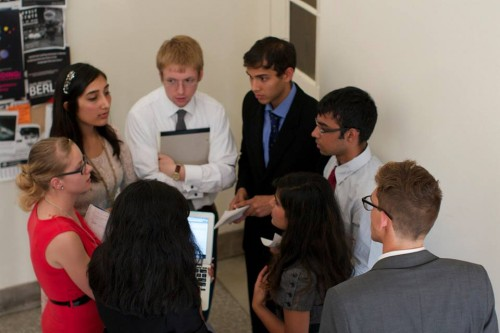 Delegates from the Myanmar committee meet in an unmoderated caucus.