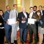 The Florida International University Delegation poses with their awards
