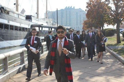 AdHoc Crisis Director Akhilesh Goswami leads the Kennedy Club to a crisis update (Photo courtesy of UPMUNC).