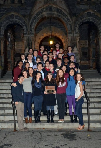 Georgetown poses with their Outstanding Small Delegation honors on the steps of Healy Hall on campus.