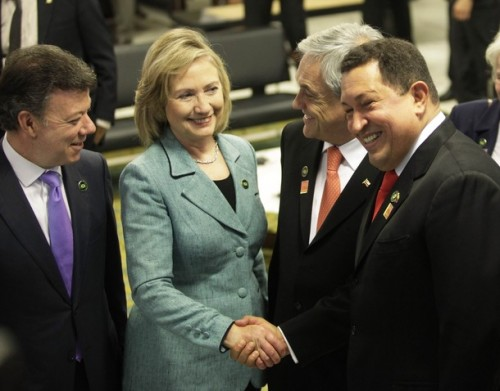 Hilary Clinton gets the upper hand on Hugo Chavez, much to the amusement of Presidents Santos and Piñera.