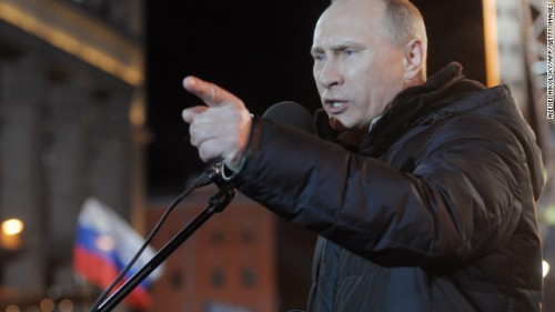 Vladmir Putin is shown above making a speech kicking USAID out of Russia, clearly using the finger-point.