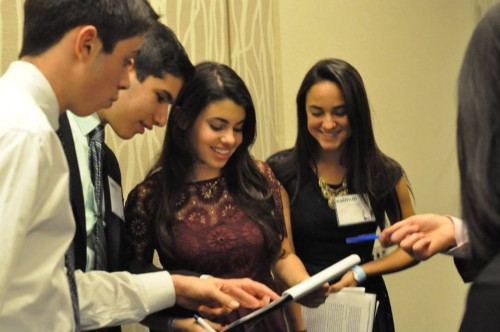 Delegates review a draft resolution during unmoderated caucus
