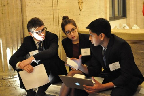 Delegates negotiate their resolution outside the DISEC room