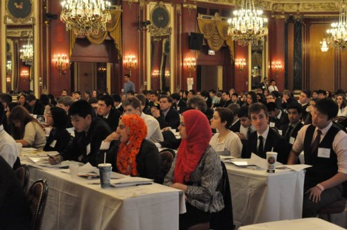 Delegates in IAEA listen during committee session in the beautiful Red Laquer room at the Palmer House Hilton.
