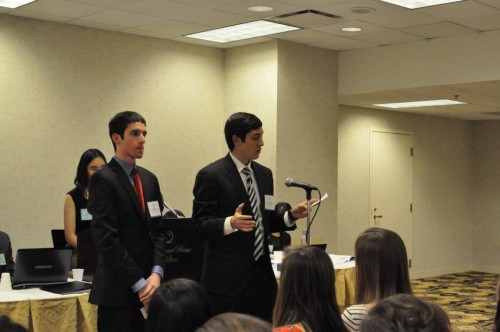 Co-delegates deliver a speech together in the UN Population Fund
