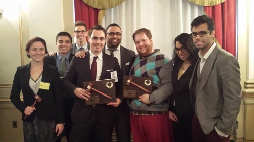 The Head Delegates for the University of Chicago (right) and Florida International University (left) pose for a picture with their Large Delegation awards.
