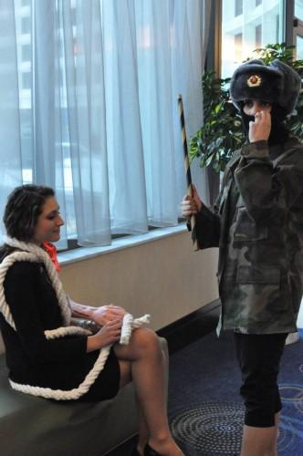A crisis staffer and a delegate enact a crisis scenario for the cameras