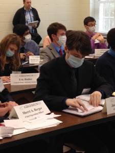 Delegates in the Centers for Disease Control (CDC) committee wear masks following a deadly pandemic.