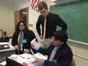 Crisis staff for the League of Extraordinary Gentlemen respond to delegates' notes.