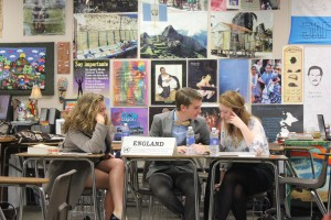 The England delegates work together to discuss strategy in the Diplomacy Committee