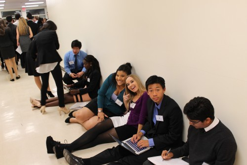 Delegates working on resolutions during break time
