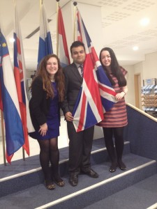 Delegates find their university country flag at the European Parliament