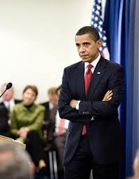 President Obama does not look too thrilled with whatever he's hearing