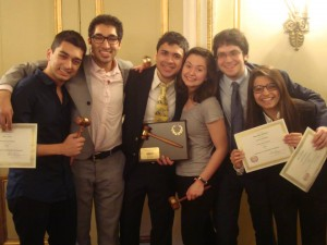 Crisis Director Chirag Sachar poses with several UChicago delegates and their awards at HNMUN's Sixtieth Session.