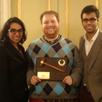 University of Chicago Head Delegates Nisha Bala, Eric Wessan, and Apratim Gautam are all smiles with their Best Large Delegation award at HNMUN 2014.