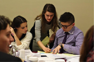 Delegates in the Saudi Arabian Revolution, 2020 committee at UPMUNC work together to draft up a directive.