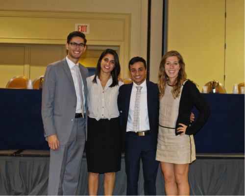 Chief Operating Officer Paul Marvucic, Director-General Haley Zarrin, Secretary-General Ashu Goel, and Chief of Staff Eliza Rothstein pose for a picture at closing ceremonies.