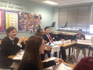 Delegates smile in their Security Council crisis