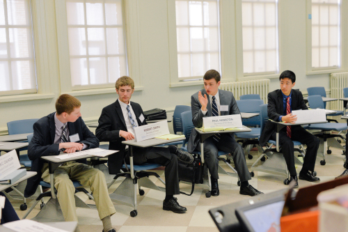 Delegate representing Paul Hamilton negotiates with the U.S. Cabinet in the JCC.