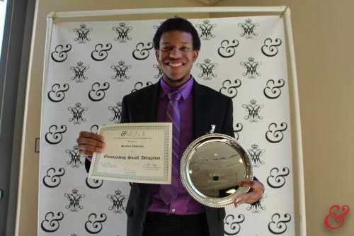 Julien Brinson receives the Outstanding Small Delegation award on behalf of Stanford University