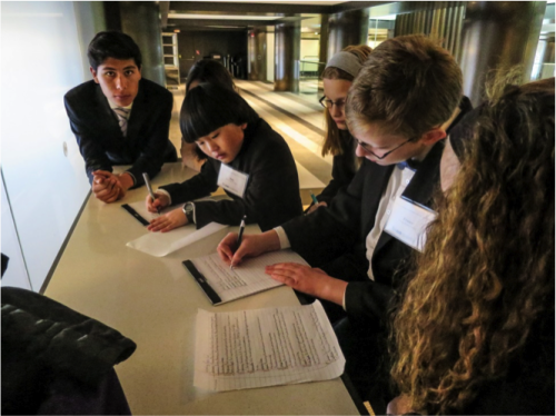 Delegates collaborate on a working paper during an unmoderated caucus.