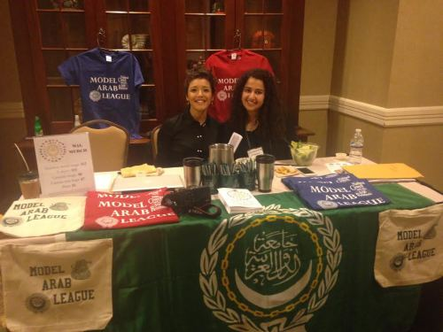 National Council on U.S.-Arab Relations representatives smile at the NCUSAR table!