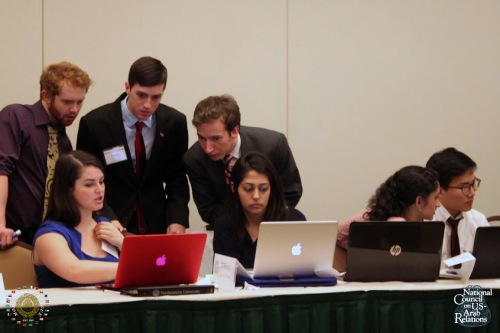 Delegates look over draft-resolutions before their presentation to the committee body
