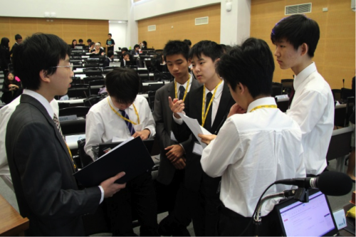 Delegates discussing committee topics during a moderated caucus.