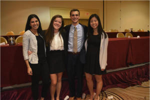 Chief of Staff, Mira Naseer, Secretary-General, Taylor Lewis, Director-General, Alex Sands, and Chief Operating Office, Jialin Zhang, smile for a photo after Closing Ceremonies and celebrate the end of an amazing UPMUNC!