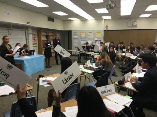 Delegates raise placards.