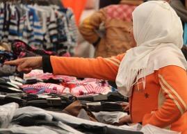 A girl picks her clothing in one of the shops.