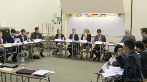 Delegates discuss the impending issues facing the Cabinet of the Dalai Lama by nearby nations such as China, India, and Pakistan. Taken by Aswathy Aji.