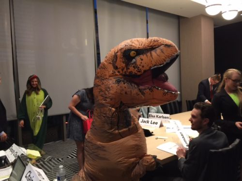 The Secretary-General dresses up as a dinosaur during a crisis update for the Ingen Board of Directors, which dealt with the topic of Jurassic Park
